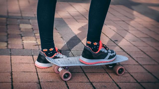 woman wearing leggings on skateboard